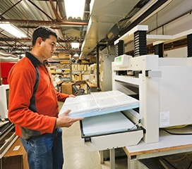 ORNL researcher Kaushik Biswas analyzes the thermal performance of a 2 x 2 foot composite panel covered with smaller MAI panels separated by foam insulation.