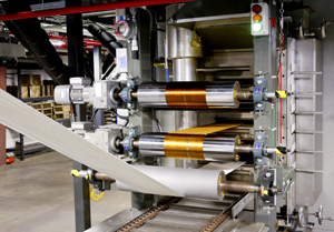 The Department of Energy's Carbon Fiber Technology Facility operated by Oak Ridge National Laboratory is accepting proposals from companies that want to test low-cost carbon fibers manufactured at the pilot scale plant. Pictured here are textile-grade acrylic fibers entering the first of four oxidation ovens, where they gradually turn from white to yellow, auburn, brown, then black. Once fully oxidized, the fiber is ready to run through the higher-temperature furnaces, which convert the oxidized fiber to carbon fiber.