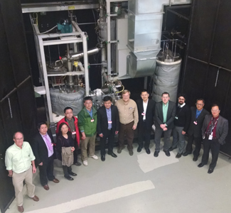 Representatives from Oak Ridge National Laboratory and the Shanghai Institute of Applied Physics (SINAP) met at ORNL to discuss plans for building a salt-cooled test reactor. Pictured in front of ORNL's molten salt test loop are (from left) David Felde, ORNL; Yang Zou, SINAP; Guanyuan Wu, SINAP; Xiaohan Yu, SINAP; Naxiu Wan, SINAP; Zhimin Dai, SINAP; David Holcomb, ORNL; Kun Chen, SINAP; Kevin Robb, ORNL; Mike Laufer, University of California at Berkeley; Guimin Liu, SINAP; Weiju Ren, ORNL.