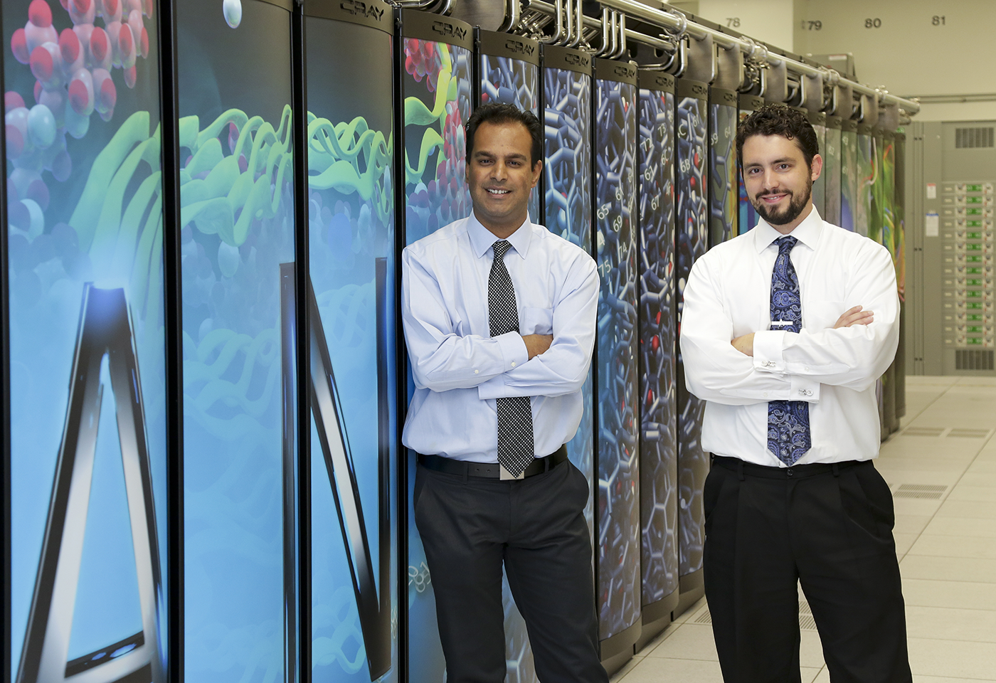 ORNL buildings researchers Jibonananda Sanyal, left, and Joshua New are developing software that will automatically calibrate models for simulating building energy use.