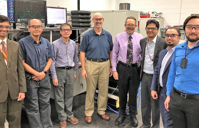Researchers demonstrated 120 kilowatt wireless power transfer at the National Transportation Research Center, a DOE Office of Science User facility at Oak Ridge National Laboratory. From L-R: ORNL's Saeed Anwar, Burak Ozpineci, Gui-Jia Su, and David Smith