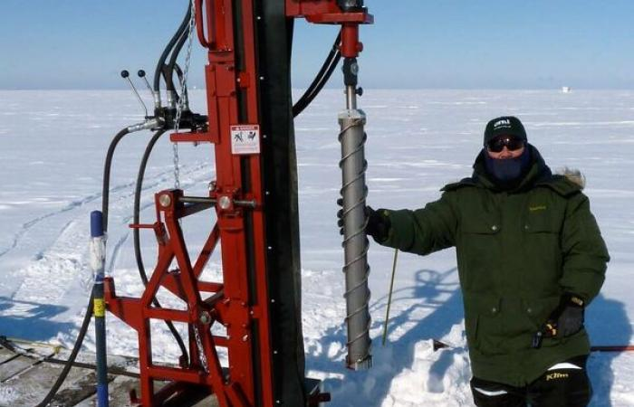 ORNL researcher in arctic with dig equipment