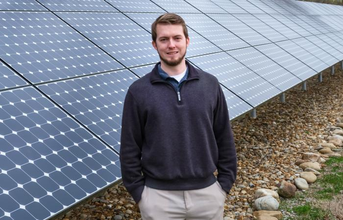 Ben Ollis standing in front of the ORNL Solar Array
