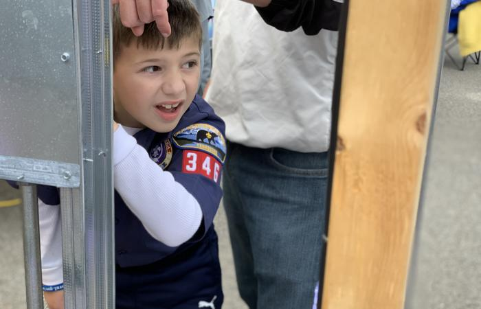 "Liam Robinson, 7, from Knoxville Cub Scout Pack 346, checked out a display of home electrical wiring and picked up a pair of high-voltage-rated channel locks at the Facilities & Operations exhibit staffed by electrician Jonathan Crowley. ""He was picking up stuff … and loving every bit of it,"" said Liam's father, Will Robinson."