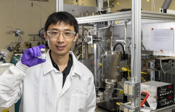 Zhenglong Li holds a sample.