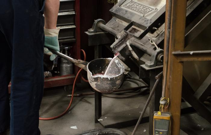 Alloyed metals being poured from a furnace into a ladle, to be used to fill molds. Image credit: Zachary Sims, ORNL