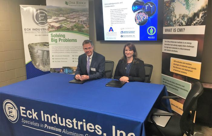 ORNL Director of Technology Transfer Michael Paulus, Eck Industries President Kiley Eck Hayon, at the licensing ceremony.