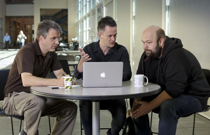 From left, Center for Accelerated Application Readiness researchers Thomas Papenbrock, Gaute Hagen and Gustav Jansen discuss improving codes that must run on increasingly more powerful supercomputers.