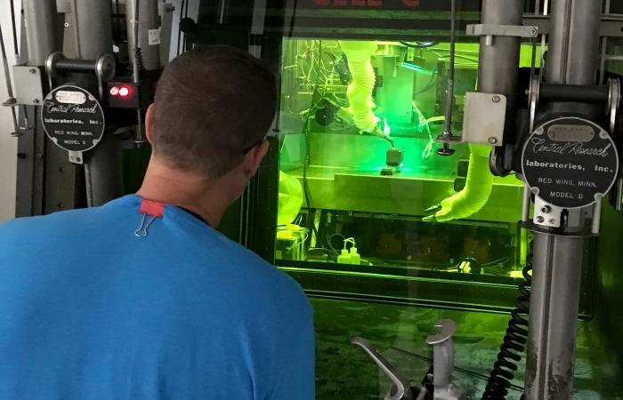 ORNL and EPRI built an enclosed welding system in a hot cell of ORNL's Radiochemical Engineering Development Center. C. Scott White (ORNL) performs operations with remotely controlled manipulators and cameras.