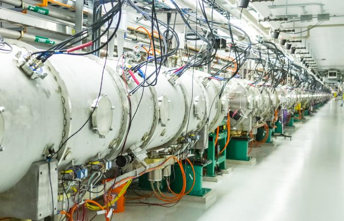 At SNS's Beamline 13, protons hit a target of mercury, an atom with a big nucleus capable of releasing a slew of energetic particles. These particles enter a moderator that decreases their energies. Some of the particles, called pions, are charged and lig