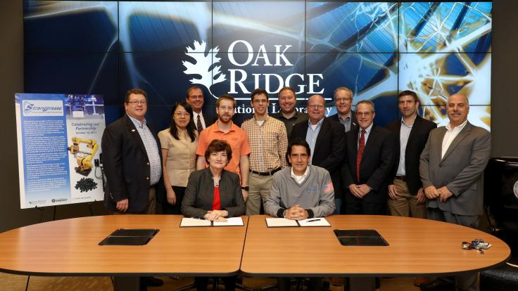 Teams from Oak Ridge National Laboratory and industry partner Strangpresse celebrate their collaboration during a technology license signing ceremony held at ORNL