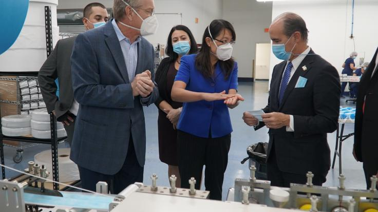 U.S. Department of Energy Deputy Secretary Mark Menezes (right) tours the DemeTECH N95 filter material production area with Xin Sun, ORNL interim associate laboratory director (center) and Craig Blue, ORNL advanced manufacturing program manager. Credit: US Dept. of Energy