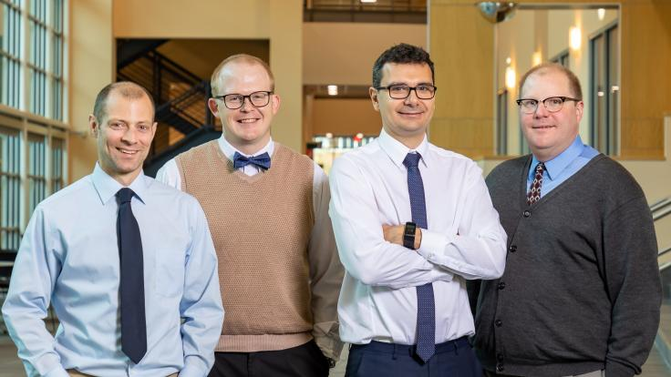 Brian Williams, Joseph Lukens, Pavel Lougovski, and Nicholas Peters (from left), research scientists with ORNL's Quantum Information Science Group, have demonstrated two simultaneous operations on two qubits