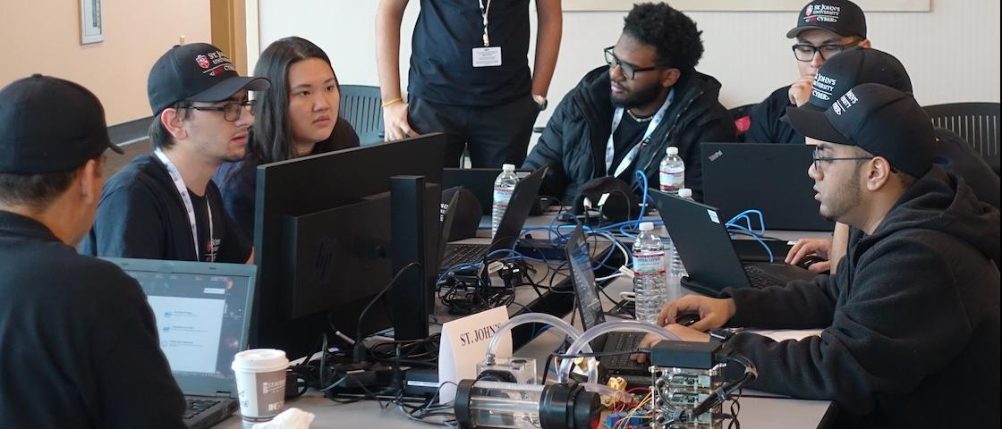 The St. John's University team prepares to compete at ORNL during the December 2018 CyberForce event. Credit: Jeffrey A. Nichols/Oak Ridge National Laboratory, U.S. Dept. of Energy