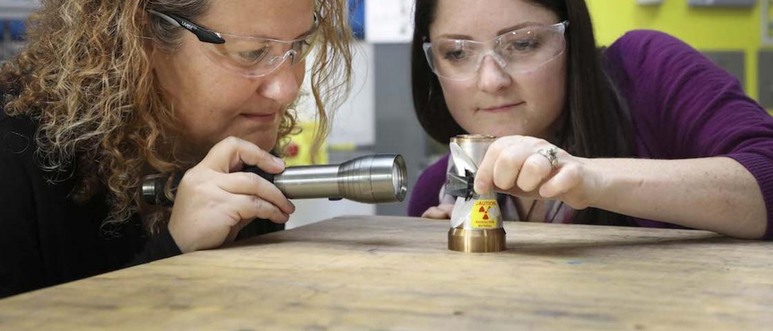 ORNL's Bianca Haberl and Amy Elliott examine a 3D-printed collimator — an invention that has been licensed to ExOne, a leading binder jet 3D printer company. Credit: Genevieve Martin/Oak Ridge National Laboratory, U.S. Dept. of Energy