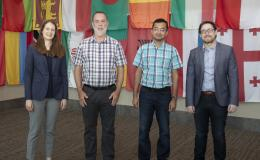 ORNL staff members (from left) Ashley Shields, Michael Galloway, Ketan Maheshwari and Andrew Miskowiec are collaborating on a project focused on predicting and analyzing crystal structures of new uranium oxide phases. Credit: Jason Richards/ORNL