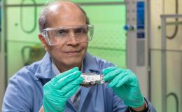 Oak Ridge National Laboratory's Ramesh Bhave co-invented a process to recover high-purity rare earth elements from scrapped magnets of computer hard drives (shown here) and other post-consumer wastes. Credit: Carlos Jones/Oak Ridge National Laboratory, U.S. Dept. of Energy