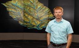 Ethan Coon uses math and computational science to model the flow of above and belowground water in watersheds.