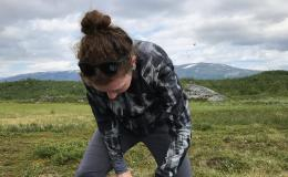 Elizabeth Herndon takes a soil sample at a field site outside Abisko, Sweden in July 2019.