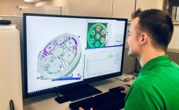 Researcher Chase Joslin uses Peregrine software to monitor and analyze a component being 3D printed at the Manufacturing Demonstration Facility at ORNL. Credit: Luke Scime/ORNL, U.S. Dept. of Energy.