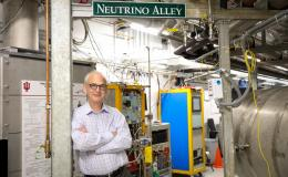 ORNL's Marcel Demarteau inspects experiments along Neutrino Alley at the Spallation Neutron Source, which makes neutrinos as a byproduct. Credit: Genevieve Martin/ORNL, U.S. Dept. of Energy