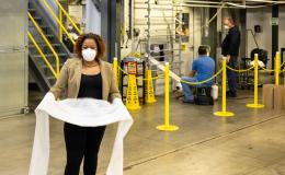 Merlin Theodore holding N95 mask filtration material produced at DOE's Carbon Fiber Technology Facility