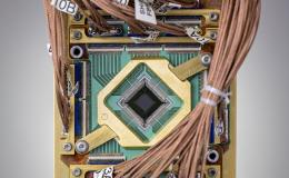 The researchers embedded a programmable model into a D-Wave quantum computer chip. Credit: D-Wave