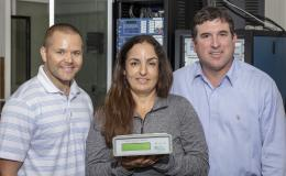 L-R, Researchers Nils Stenvig, Isabelle Snyder and Travis Smith are developing tools and deploying sensors to aid decision-making as Puerto Rico rebuilds and modernizes its power grid.
