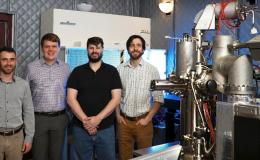 Eugene Dumitrescu, Ben Lawrie, Matthew Feldman, and Jordan Hachtel (from left) have conducted investigations aimed at controlling the dissipative nature of quantum systems and materials. The cathodoluminescence microscope used in their work appears at rig