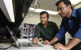 ORNL researchers Gautam Thakur (left) and Teja Kuruganti demonstrate UrbanSense, a novel sensor network aimed at helping cities manage their growth and evaluate future development opportunities. The platform collects open-source population, traffic and en
