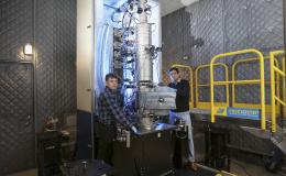 From left, Andrew Lupini and Juan Carlos Idrobo use ORNL's new monochromated, aberration-corrected scanning transmission electron microscope, a Nion HERMES to take the temperatures of materials at the nanoscale. Image credit: Oak Ridge National Laboratory