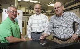 From left, ORNL's Rick Lowden, Chris Bryan and Jim Kiggans were troubled that target discs of a material needed to produce Mo-99 using an accelerator could deform after irradiation and get stuck in their holder.