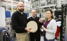 ORNL researchers Todd Toops, Charles Finney, and Melanie DeBusk (left to right) hold an example of a particulate filter used to collect harmful emissions in vehicles.