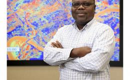 "A senior research scientist at Oak Ridge National Laboratory, Olufemi ""Femi"" Omitaomu is leveraging Big Data for urban resilience. Image credit: Oak Ridge National Laboratory, U.S. Dept. of Energy; photographer Jason Richards."