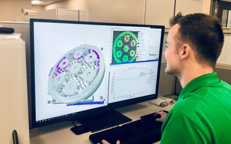 Researcher Chase Joslin uses Peregrine software to monitor and analyze a component being 3D printed at the Manufacturing Demonstration Facility at ORNL. Credit: Luke Scime/ORNL, U.S. Dept. of Energy