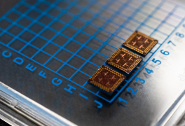 ORNL-developed cryogenic memory cell circuit designs fabricated onto these small chips by SeeQC, a superconducting technology company, successfully demonstrated read, write and reset memory functions. Credit: Carlos Jones/Oak Ridge National Laboratory, U.S. Dept. of Energy